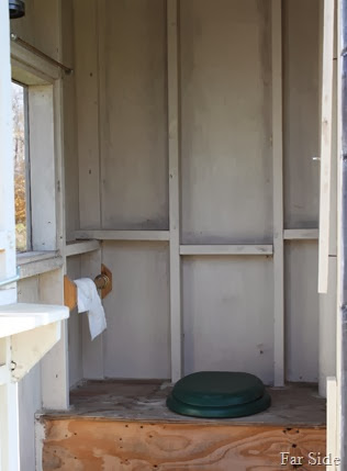Outhouse with a cushioned seat