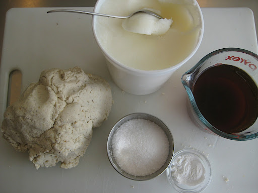 Ingredients needed to make the finished dough. Corn masa, lard or shortening, stock/broth or water, baking powder and salt.