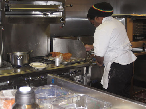 Michael Garrett, a member of Marcus' kitchen staff, helped Marcus with preparations for his chicken.