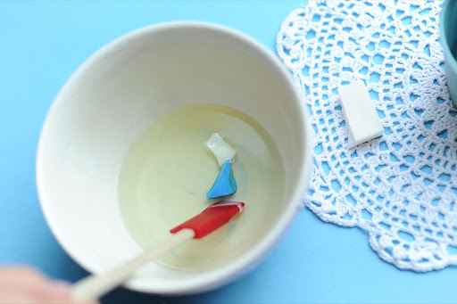 Step 5: Remove the wax from heat, and add the candle color of your choice. We, of course, chose powder blue.