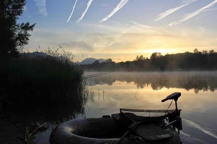Alex fishing boat on lake