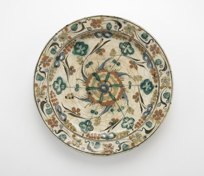 Plate with low foot | Origin:  Iran | Period: early 17th century  Safavid period | Details:  Not Available | Type: Stone-paste painted under glaze | Size: H: 5.9  W: 34.0  cm | Museum Code: F1903.229 | Photograph and description taken from Freer and the Sackler (Smithsonian) Museums.