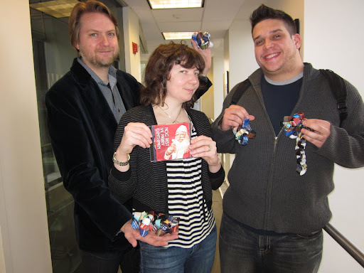 Scott and Steve display their bows, and Maura holds another crafty holiday gift: a mix CD of Christmas tunes.  Scott makes one every year for his friends, never repeating a song!