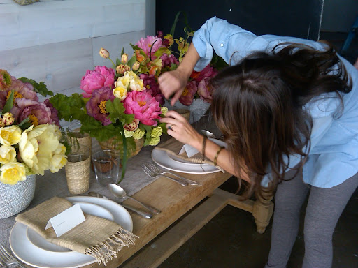 Livia works her magic on the centerpieces.