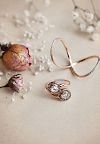 Jewelry designer Meredith Kahn's bridal collection includes the Delane ring (bottom), with two rose cut diamonds, and the white diamond Love Twist ring (top).