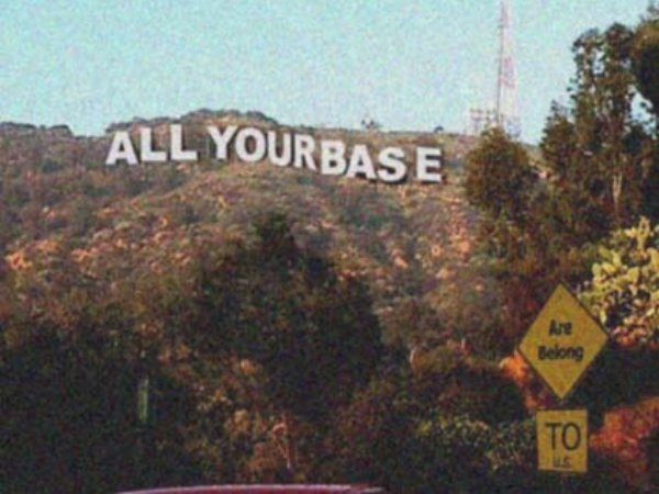 "Hollywood style sign on hillside ""All your base"""