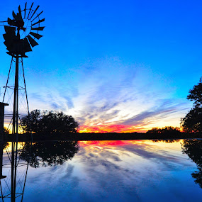sunset reflection on stock tank by Phil Olson - Landscapes Sunsets & Sunrises ( farm, ranch, reflection, waterscape, sunset, windmill,  )
