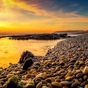 Warm pebbles by Ricardo  Guimaraes - Landscapes Beaches ( smooth, peaceful, waterscape, beach, colorfull, quiet, landscape, contrast, sunset, silence, wet, portugal, nikon, light, , relax, tranquil, relaxing, tranquility )