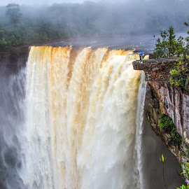 Standing on the edge by Mike O'Connor - Landscapes Waterscapes ( water, precipice, danger, edge, guyana, overhang, rocks, kaieteur falls )
