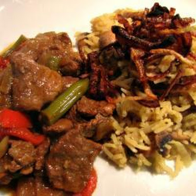 Goan Pork Curry With Mushroom Pilaf And Crispy Onions