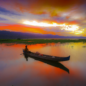 A Man On Boat at Limonto by Andrial Kusuma - Landscapes Sunsets & Sunrises ( water, red, sunset, lake, sunrise )
