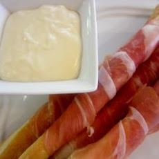 Prosciutto-wrapped Grissini Breadsticks With Cheese Sauce
