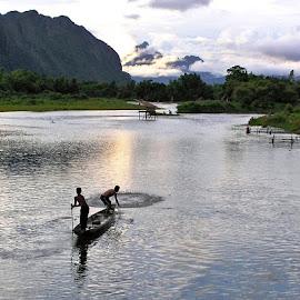 Vang Vieng fishermen by Mark Beardsley - Landscapes Travel ( fishermen, mountains, fishing boat, se asia, river )