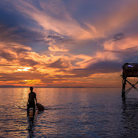 Fisherman by LietHung Tran - Landscapes Waterscapes ( clouds, skyline, sky, colorful, colors, clouds and sea, guardhouse, sunrise, fisherman, man )