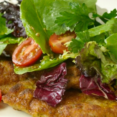Veal Milanese topped with field greens and grape tomato salad