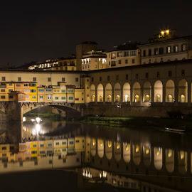 Ponte Vecchio at Night by Bill Kuhn - Buildings & Architecture Public & Historical ( water, nigh, reflection, vecchio, tourism, travel, fiume arno, ponte, arched river bridge, ponte vecchio, bridge, roman, italy, river )