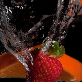 Strawberry and Orange Splash by Leon James - Food & Drink Fruits & Vegetables ( splash, drop, purity, falling, fresh, lifestyle, wellness, black, water, orange, fruit, refreshment, delicious, health, vitality, strawberry, bubble, pure, liquid, red, sweet, food, healthy, freshness, vitamin,  )