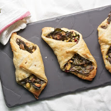 Swiss Chard Turnovers with Parmesan and Pistachios