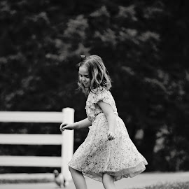 Baylee by Ali Reagan - Babies & Children Children Candids ( blackandwhite, girl running, dress, fun, youth, dog, laughter )