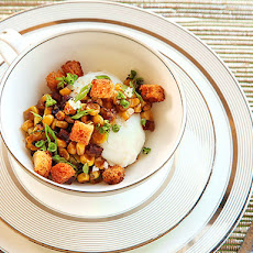 Poached Eggs With Corn, Chorizo, Basil, and Brioche Croutons