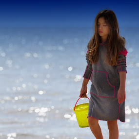 Blue dreamscape by Joe Proctor - People Portraits of Women ( girl, sparkly, blue, bucket, pale, beach )