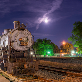 An old locomotive at night at Collierville Historic Train Depot  by Konrad Dwojak - Transportation Trains ( collierville town square, collierville, train depot, locomotive, full moon, historic train depot, night )