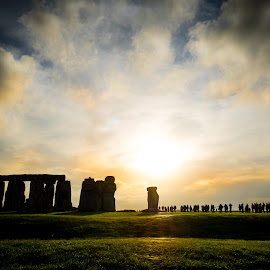 Stonehenge light by Andy Boyce - Landscapes Cloud Formations ( clouds, orange, stonehenge, green, silhouette, stone, people, historic, sky, henge, blue, sunset, monument, light )