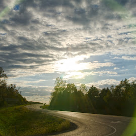 the portal by Jody Jedlicka - Landscapes Cloud Formations ( clouds, fall, road, landscape, lens flare )