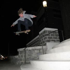 Nikk Vanscoy Ollie by Stevie Gandy - Sports & Fitness Skateboarding ( #ollie #rain #skateboarding #dreads )