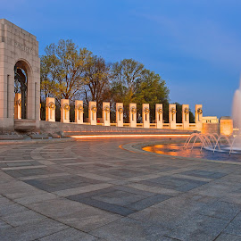 Washington DC World War II Memorial by Nicolas Raymond - Buildings & Architecture Statues & Monuments ( ww2, freedom, bright, stone, round, vibrant, yellow, travel, architecture, glow, historic, heritage, city, colour, lamps, circular, washington, colourful, sky, fluid, foliage, remembrance, pacific theatre, light, oval, black, dc, orange, structure, memorial, colors, national, white, tourism, united states, somadjinn, colours, landmark, rememberance, touristic, dawn, classical, fountain, scene, trees, lines, golden, legacy, pacific theater, wwii, america, colorful, tribute, circle, usa, war, curves, lights, liberty, circles, nicolas raymond, american, long exposure, grey, monument, gold, national mall, classic, water, building, hdr, green, scenic, gray, morning, world war ii, history, world war 2, urban, cyan, color, blue, vibrance, background, washington dc, glowing, scenery, historical, curved, world, mall,  )