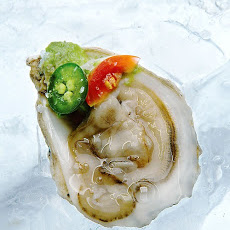 Oysters with Serrano Chile, Avocado, and Cherry Tomatoes