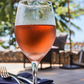 a glass of Rosé by Vibeke Friis - Food & Drink Alcohol & Drinks ( wine, glass, table setting )