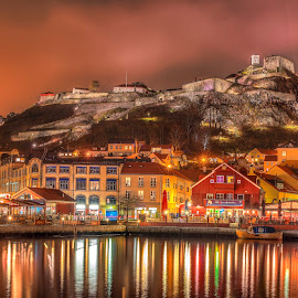 Halden - Norway by Johannes Mikkelsen - Landscapes Waterscapes ( mountain, bright, colorful, waterscape, harbour, reflections, ocean, architecture, landscape, glow, dock, norway, city, lights, night photography, awesome, fortress, d800, buildings, norge, nikon, fairytale, photoshop, water, photomatix, hdr, colors, sea, seascape, nightscape, amazing, magic, halden, castle,  )