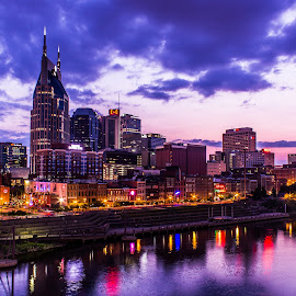 Music City Sunset by Mike Martin - City,  Street & Park  Skylines ( music city, cumberland river, sunset, nashville, tennessee, city lights, night, long exposure, cityscape, usa, river,  )