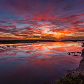 Blazing Mirror by Clive Wright - Landscapes Sunsets & Sunrises ( water, reflection, kromme, landscape, fire, river )