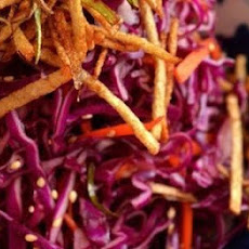 Red Cabbage Salad with Crispy Spring Onions and Potato Sticks