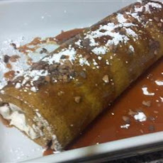 Pumpkin Roll with Toffee Cream Filling and Caramel Sauce