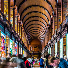 Trinity College Library by Robert Willson - Buildings & Architecture Public & Historical ( wooden arch, books, book of kells, old, ireland, arch, historic architecture, dublin, college, trinity college library, arch ceiling, architecture, historic library, robert willson, historic, old books, historic books, bob willson, trinity, leather books, leather )