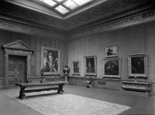 Unfortunately, there were no photographs taken of the Frick Residence before Frick's death in 1919; however, these photographs taken in 1927 reflect the Frick residence as it was during his lifetime.  The Rembrandt paintings were hung together on the north wall of the West Gallery.