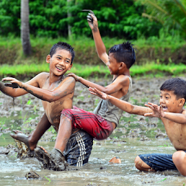 Playing on the mud by Sigit Purnomo - Babies & Children Children Candids