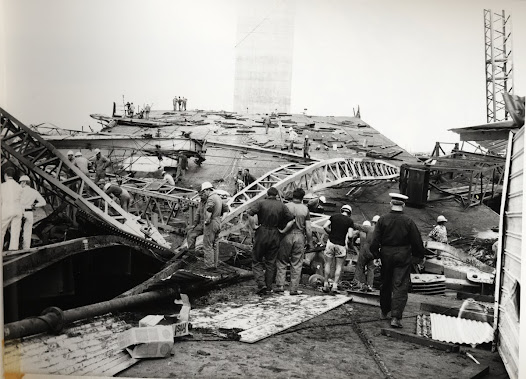 An official party inspecting the disaster site