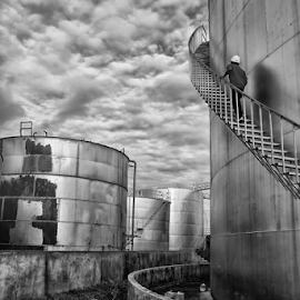 Oil Refinery by Ferdinand Ludo - People Professional People ( oil refinery, men at work, storage tanks, inspections )