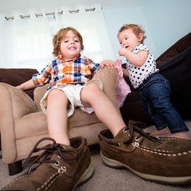 Shoes to Fill by Mike DeMicco - Babies & Children Children Candids ( shoes, silly, playing distorted, happy, wide angle, funny, children, kids, cute, siblings, large )