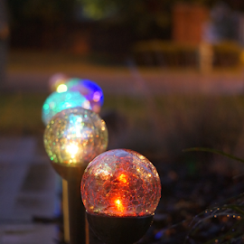 Lights by Michelle Cain - Artistic Objects Other Objects ( indiana, orange, green, yellow, storm, red, color, blue, summer, cracked, night, light, globe, sidewalk )