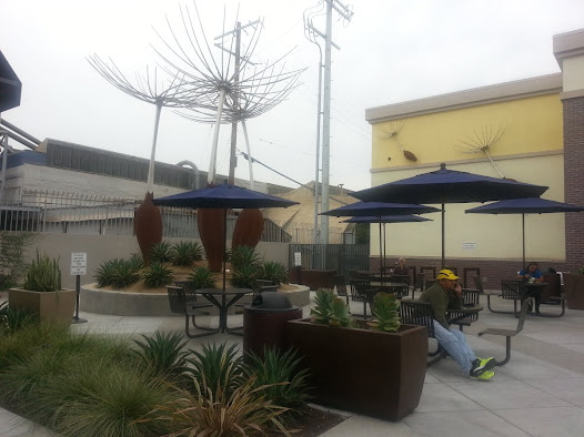 "The public space surrounding ""Wish"", in a quiet corner of the busy shopping center, provides an attractive area with seating and native landscaping."