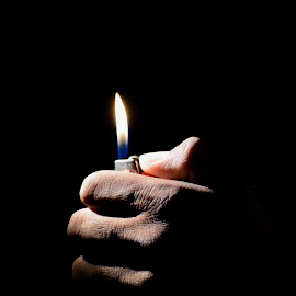 Hand with the lighter by Sathyanarayanan Shanmugam - People Body Parts