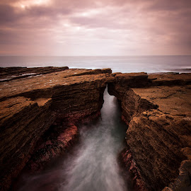 Undertow. by Piotr Dominiak - Landscapes Waterscapes ( ireland, hook head, long exposure, seascape, sunrise )