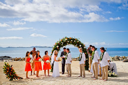 Couple exchanging their vows on the beach, Castaway Island Fiji
