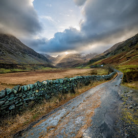 Valley Sunlight by Adrian Evans - Landscapes Mountains & Hills ( adrian evans, north wales, light beam, photograph, mountain, wales, farmhouse, stone, snowdonia national park, road, valley, landscape, farm, sky, tree, ogwen, dry stone, snowdonia, sunbeam, clouds, uk, idwal, building, nant ffrancon, light ray, shadows, pass, winter, outdoor, fall, ogwen valley, sun light, wall )