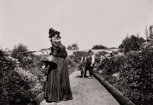 Lady of the house directing the gardeners at Monivea Castle, Athenry, Co. Galway, ca. 1900. (ALB 50).